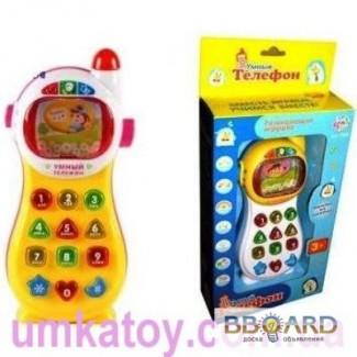 Продам интерактивную развивающую игрушку - музыкальный телефон 7028