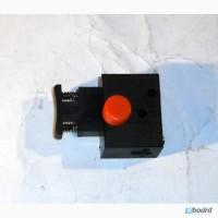 Кнопка включения цепной электропилы