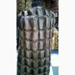 Удлиненная жилетка из меха енота с кожаными вставками